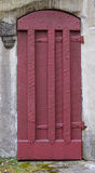 Medieval Castle Doorway. Old red door on a masonry building Royalty Free Stock Images