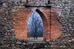Medieval castle in Eastern Europe. Medieval castle and window seen in Eastern Europe Royalty Free Stock Photo
