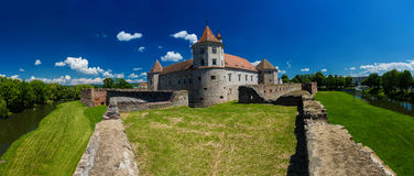 Medieval castle Fagaras Romania. Medieval castle and it's water reflection, Fagaras, Romania royalty free stock images