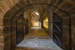 Medieval castle fortress interior wall dungeon dark canon balls. Gate stock image