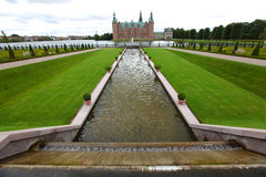 Medieval castle with gardens and fountains Stock Photo