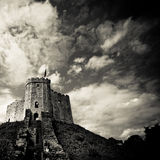 Medieval castle on hill. Old medieval castle high on a hill. Black and white to intensify mood stock photography