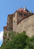 Medieval castle on hill. Closeup of the massive walls of a medieval castle built on a hill Royalty Free Stock Images