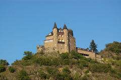 Medieval castle on hill Stock Images