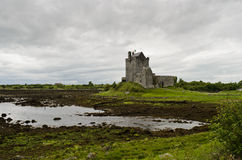 Medieval castle in Ireland. Medieval Dunguaire castle under a grey sky in Kinvara, county Galway, in Ireland Royalty Free Stock Photos