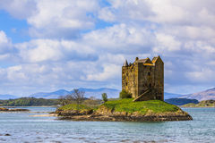 Medieval castle on a island in the water Royalty Free Stock Images