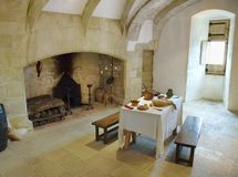 Medieval Castle Kitchen. Ancient interior of a medieval castle kitchen in use. Castelnaud, Dordogne, France stock image