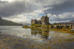 Medieval castle on the lake. Big medieval castle on the peaceful lake, Scotland, United Kingdom royalty free stock photography
