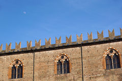 Medieval castle landscape. Ancient  facade,  tower,  windows under canopy of trees Royalty Free Stock Photography