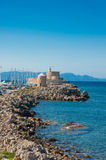 Medieval castle and lighthouse in old town of Rhodes, Greece. Royalty Free Stock Photography