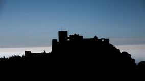 Medieval castle of Loarre backlit and sun in Huesca, Spain Stock Photo