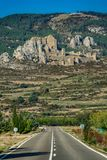 Medieval castle of Loarre and straight road, Aragon, Spain Royalty Free Stock Photos