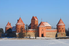 Medieval castle in the middle of frozen lake Royalty Free Stock Photo