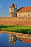 Medieval Castle mirrored in water Royalty Free Stock Image
