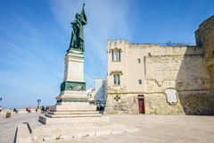 Medieval castle and monument in Otranto, Italy. Medieval castle and monument erected for heroes of 1480, Otranto, Puglia, Italy Royalty Free Stock Photography