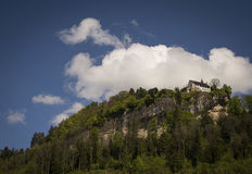 Medieval castle on a mountain Stock Photos