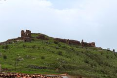 Medieval Castle in the mountains of Alcaraz, Albacete. Old castle ruins in the mountain of Alcaraz in a cloudy day of spring. Alcaraz, Albacete, Spain Stock Images