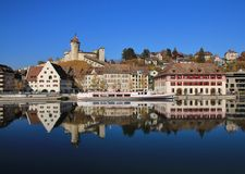 Medieval castle Munot and old houses reflecting in the river Rhi Stock Photo