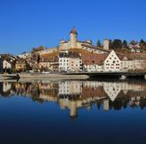 Medieval castle Munot and other old buildings mirroring in the r Royalty Free Stock Photo