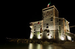 Medieval castle by night. Medieval castle on the sea - Rapallo - Ligurian sea Royalty Free Stock Photography