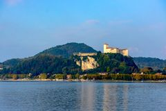 Free Medieval Castle On A Hill Surrounded By Water From The Lake Lago Maggiore. View Of The Castle Of Angers And The Alps Stock Images - 111922344