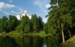 Medieval castle over lake scene Stock Photo