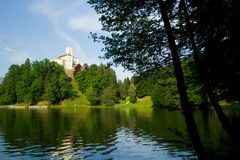 Medieval castle over lake scene Stock Images