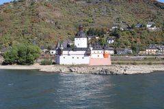 Medieval Castle Pfalzgrafenstein sitting in middle of river rhine. The medieval Castel Pfalzgrafenstein sitting on a rock bank in the river rhine. City od Kaub royalty free stock image