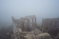 Medieval castle ruin in heavy fog view from high point Royalty Free Stock Photo