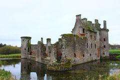Medieval castle ruin. In a small lake Stock Images