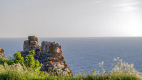 Medieval castle ruin wall and sea Royalty Free Stock Photo