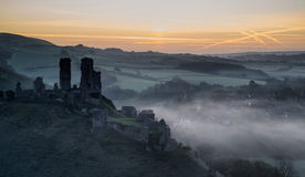 Medieval castle ruins with foggy landscape at sunrise Royalty Free Stock Photo