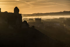 Medieval castle ruins with foggy landscape at sunrise Stock Image