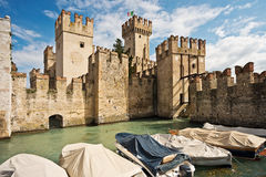 The Medieval Castle of Sirmione on the Garda's Lake. Boat and Tower in the typical italian village of Sirmione Royalty Free Stock Image