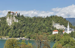 Medieval castle, St. Martins Church and Bled Lake at autumn Royalty Free Stock Image