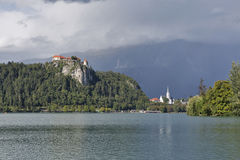 Medieval castle, St. Martins Parish Church and Bled Lake royalty free stock images