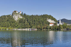Medieval castle, St. Martins Parish Church and Bled Lake stock photos