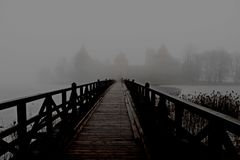 Medieval castle surrounded by fog. Black and white medieval castle surrounded by fog Royalty Free Stock Image