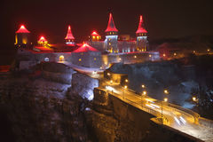 Medieval castle on top of a cliff at night. Royalty Free Stock Photography