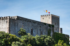Medieval castle tower and Church of San Vicente de la Barquera, Royalty Free Stock Photography