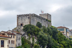 Medieval castle tower and Church of San Vicente de la Barquera, Stock Image