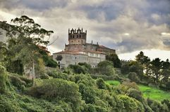 Medieval castle tower and Church of San Vicente de la Barquera Royalty Free Stock Photo