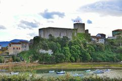 Medieval castle tower and Church of San Vicente de la Barquera Stock Photography