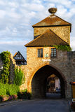 Medieval castle tower with gates and stork nest on the top Royalty Free Stock Photos