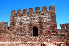 Medieval castle tower, Silves, Portugal. View of the Medieval ruins inside the castle showing with the battlements and one of the towers to the rear, Silves Royalty Free Stock Photo