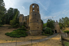 Medieval castle among trees and blue sky in Luxembourg Stock Photo