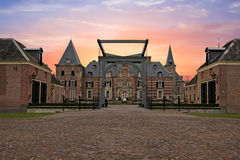 Medieval castle `Twickel` in Delden Netherlands. Medieval castle `Twickel` in Delden the Netherlands at sunset Stock Photography
