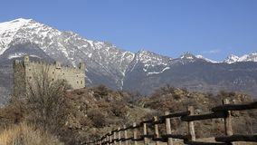 The medieval castle of Usse zoom in. Ussel fraction of Chatillon, Valle d`Aosta, Italy 11 February 2018. Three-quarter shot from the bottom to the top of the stock footage