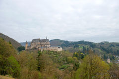 Medieval Castle Vianden. Build on top of the mountain in cloudy weather. Luxembourg Royalty Free Stock Photo
