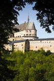 Medieval Castle of Vianden, Luxembourg. Vianden, Medieval castle on the mountain in Luxembourg or Letzebuerg, view through the trees - vertical image Royalty Free Stock Photos